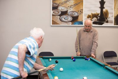 Elderly playing snooker for entertainment