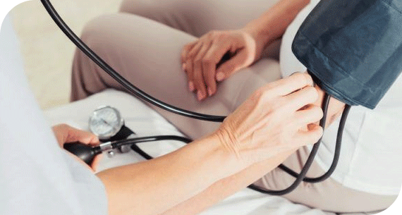 Nurse checking blood pressure of a patient