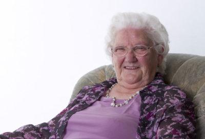 Senior woman is sitting