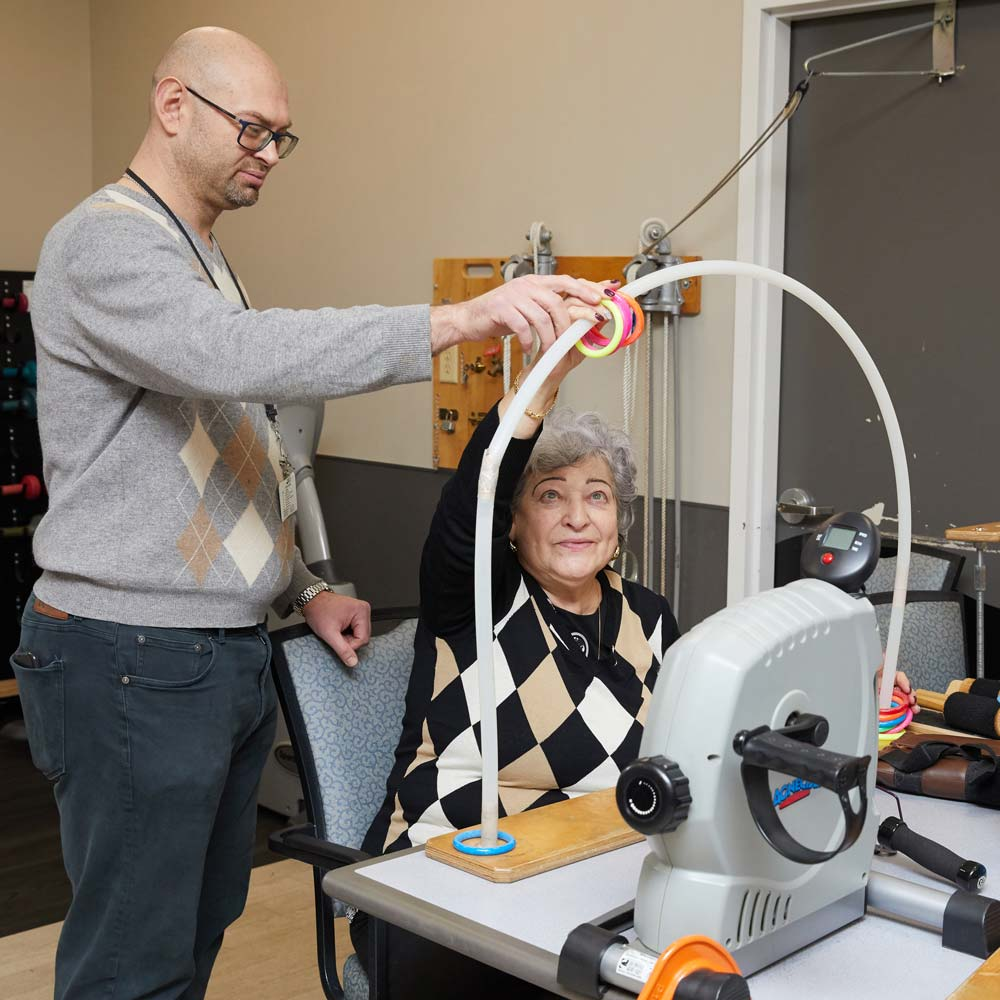 Elderly women getting physical therapy to build strength