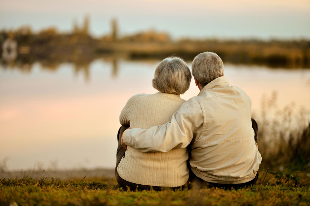 Old couple sitting in nature in an elderly day care