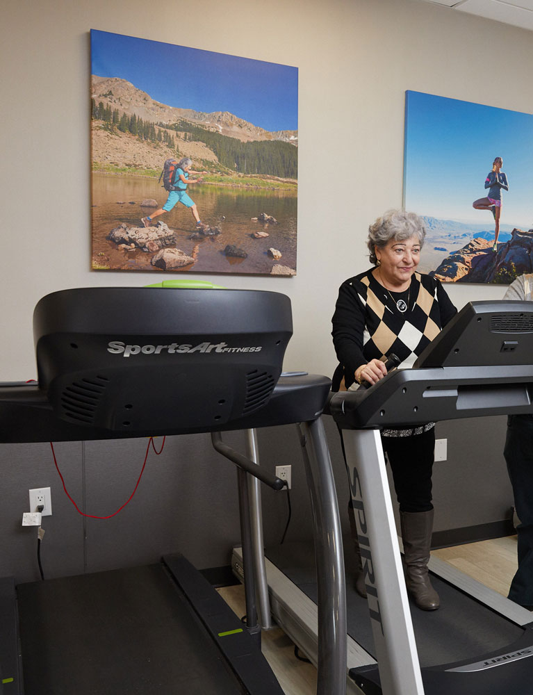 Elderly woman doing exercise on treadmill alone maintaining her inderpendence