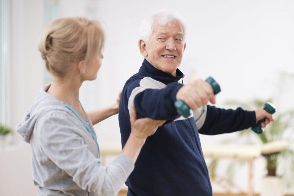 Elderly man doing exercise to avoid chronic health issues