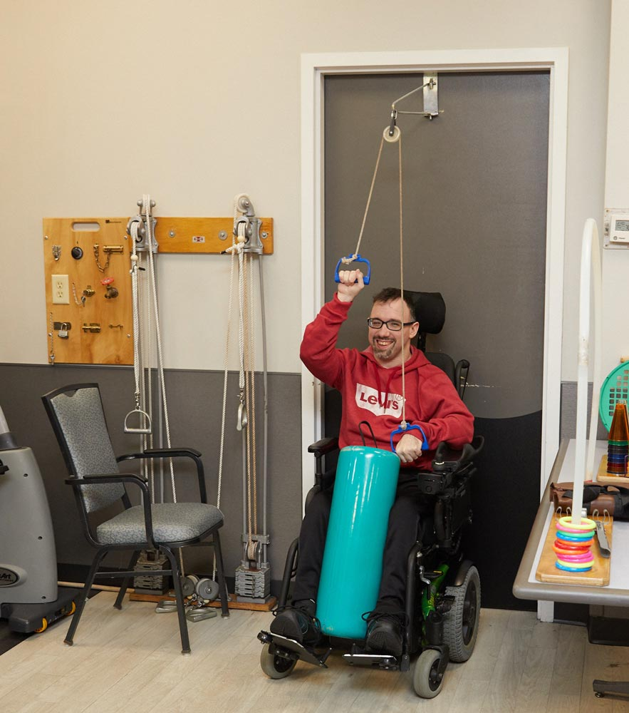 Elderly man doing exercise as a rehab after TBI