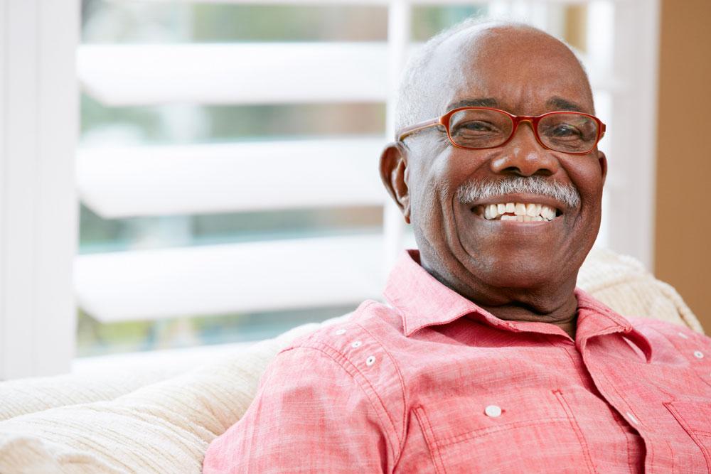 Portrait of happy senior man after getting a dental treatment