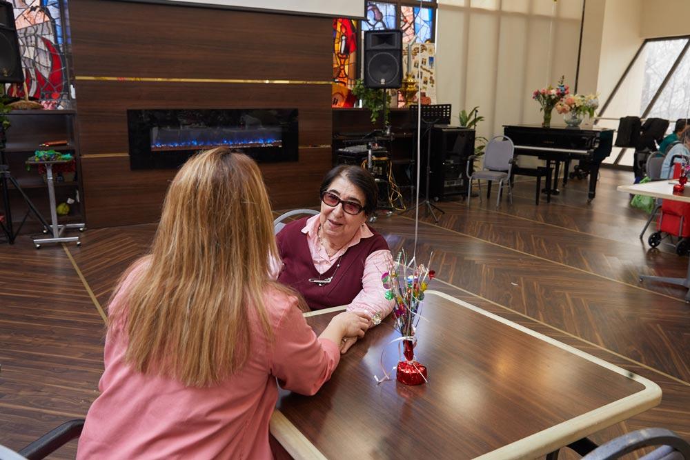 Elderly woman suffering from slurred speech getting speech therapy
